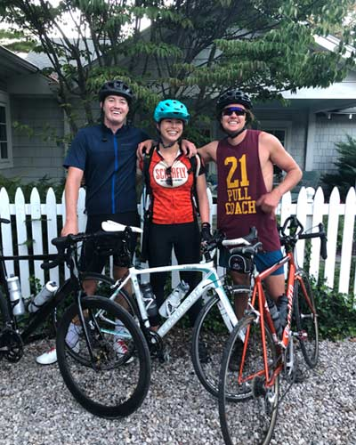 3 friends standing in front of their road bikes