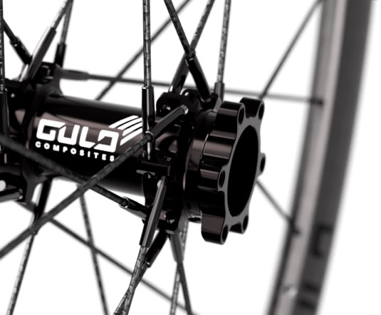 closeup of bike wheel hub with carbon fiber spokes