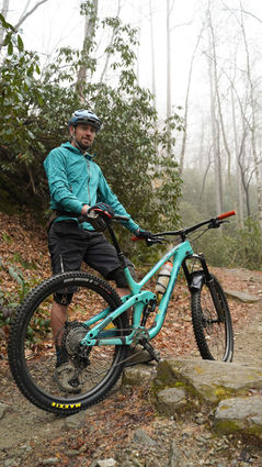 richie trent standing next to his mountain bike