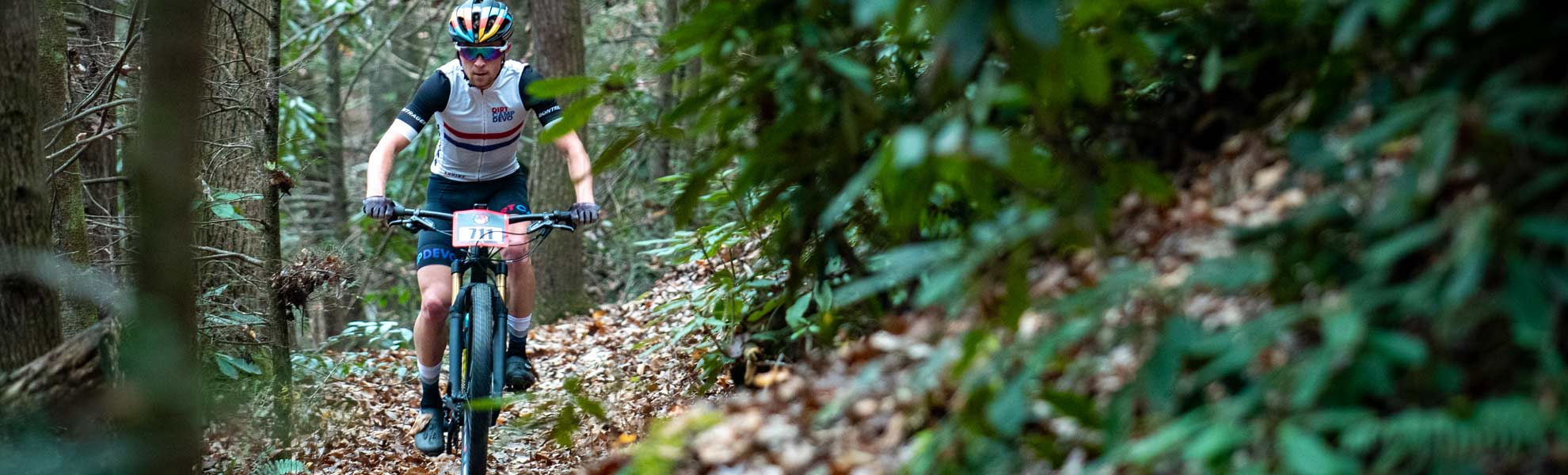 mountain biker racing on single track