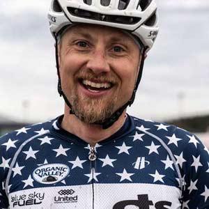 gravel cyclist smiling at camera
