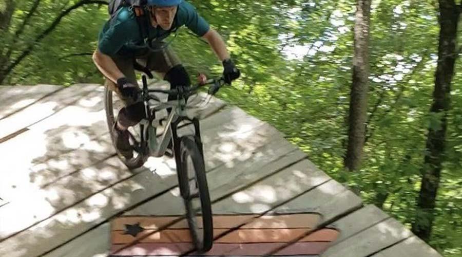 mountain biker riding on wooden deck