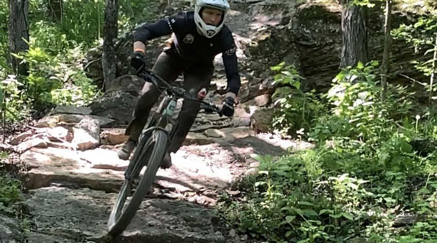 mountain biker racing on rocks