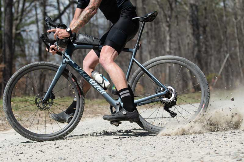gravel cyclist demonstrating the integrated wheel sytem and G1 spoke