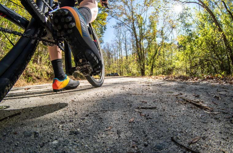 cyclist stopped on gravel road