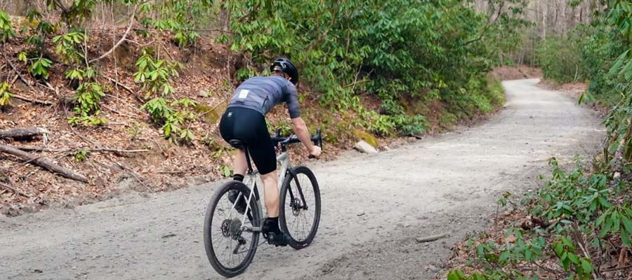 cyclist riding on gravel road